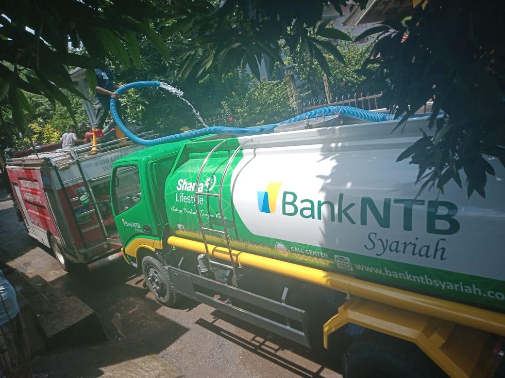 Bank_NTB_Syariah_melakukan_pembersihan_sisa_Banjir_di_Desa_Potu_Dompu.html