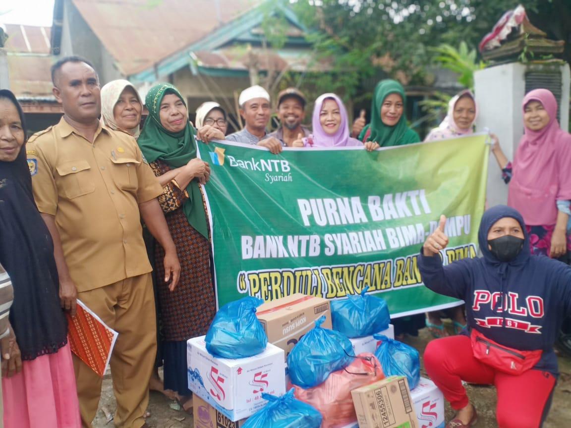 Peduli_Korban_Banjir_Purna_Bhakti_Bank_NTB_Syariah_Bima_Dompu_Salurkan_Bantuan.html
